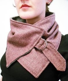 Super nice pink and brown herringbone neck warmer. Made from very soft wool blend material.  Attaches around neck with a metal buckle.  Backed with soft gray fleece.    This neck warmer is a Christina Robinson original design.