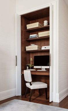 A contemporary apartment in Madison Square Park. Study nook with pocket doors