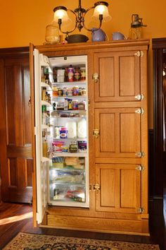 Ultimate in period style: a German Liebherr refrigerator built into custom cabinetry that looks just like an icebox. Photo by Philip Clayton-Thompson.