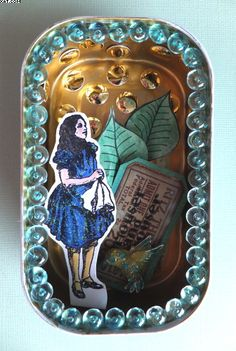Re-cycled and altered sardine tin.