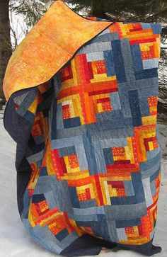 "Quilt by tubakk-quilt, via Flickr.  No contact information given.  Close inspection of the image (and notes on Flickr) reveal that what I thought was gray is actually denim, from old blue jeans.  More subtle than I would have expected from ""orange and blue,"" eg Clemson and Tennessee."
