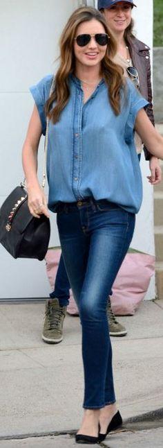 Who made  Miranda Kerr's black studded handbag, aviator sunglasses, short sleeve denim shirt, blue skinny jeans, and black ballet flat shoes?