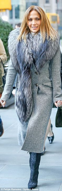 Busy schedule: The singer stepped out in a stylish winter coat with fur collar after an ap...
