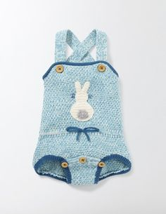This knitted romper has a hint of the traditional, with an embroidered bunny and a bow at the waist. Layer it over a body to show off those pinafore straps. The matching buttoned gusset makes dressing easy, while the soft cotton and merino wool is machine washable.