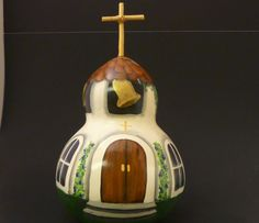This is a hand painted country church gourd with spring flowers blooming. on Etsy, $30.00