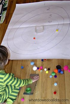 Sneak in some math practice with this super simple target range and homemade catapult.