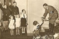 """Nazi Christmas. """"Songs that mentioned Jesus, like Silent Night, were rewritten with new lyrics espousing the benefits of National Socialism by none other than chief Nazi ideologist Alfred Rosenberg and Heinrich Himmler, one of the masterminds of the Holocaust."""""""