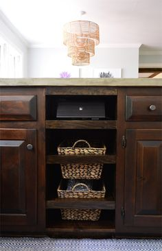 Installing pull-out baskets after removing a trash compactor. Sounds golden! Great (and pretty) storage for dish towels... and it frees up more drawer space for kitchen essentials that aren't baby-friendly.  Young House Love | Basket Case | http://www.younghouselove.com