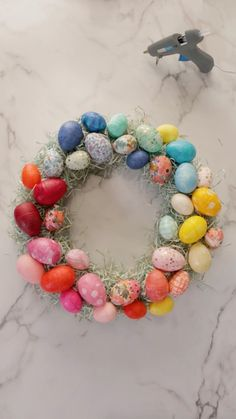 """Better Homes & Gardens on Instagram: """"It doesn't feel like spring without a plastic Easter egg craft! Make your own colorful wreath with materials found at the dollar store.…"""" #eastereggs #easter"""