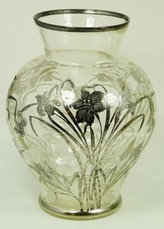 CRYSTAL VASE WITH FLORAL SILVER OVERLAY  Old Baccarat French crystal bulbous vase having a floral overlay design. Holds Baccarat watermark to bottom.