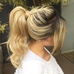 Curly Ponytail With Braid And Bangs