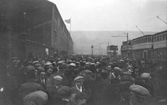 Football crowds, Town Ground, Leeds Road, Huddersfield - with special trams in the background