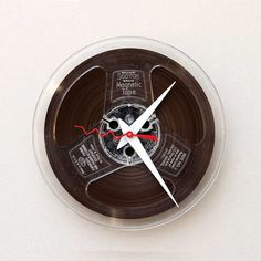 Clock made from a recycled magnetic tape reel by pixelthis on Etsy