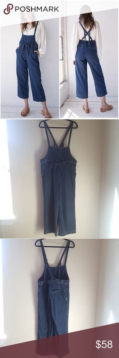 Free People Strappy Denim One Piece Size L Free People Strappy Denim One Piece Size L  - Like new condition -Worn once -Cropped wide leg -Feminine front tie -Can wear straps crossed or straight  Great modern take on overalls that can really add to your wardrobe. Can be dressed up or down, depending on the top worn with these overalls and the accessories. Free People Jeans Overalls