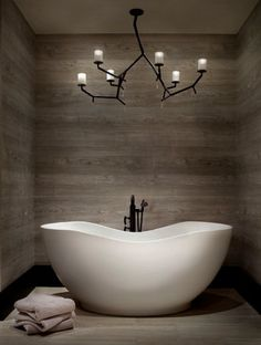 "Ceramic ""wood"" tile surrounding bathtub. love this. Dont like the candle light though"