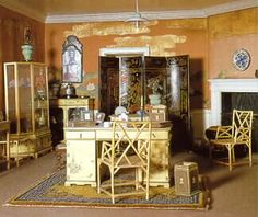 She chooses a book from her library, miniature in size but otherwise authentic, and reads some prose before beginning another long day. The figurines in this room are exact duplicates of those found in Windsor Castle. The walls are covered in real silk and the desk rests on a hand made wool rug.