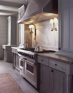 grey kitchen, cararrra marble backsplash, sconces above range Pursley Dixon