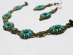 PoWoli / Jewelry set made by Sabina Bugaj.  Bracelet's lenght: about 17 cm/ 6,7 inches  Earrings' lenght: about 5 cm/ 2 inches  They were made using glass beads (they look like turquoise) and with ones that look like an old gold.