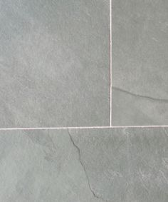 Dalian Grey riven slate flooring and wall tiles. Available in Slate strips for cladding and mosaics. www.naturalstoneconsulting.co.uk