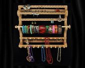 FINALLY FOUND IT!    Hanging Combo Earring Necklace Bracelet Storage Holder. $45.95, via Etsy.