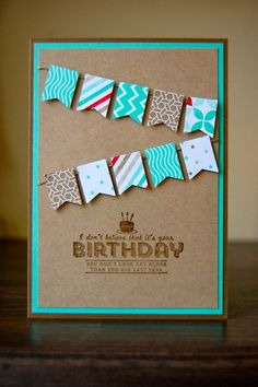 Fun birthday card, add the banners and the stamp in same color as background color.