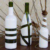 Garrafas de vinho recicladas em vasos modernos e bonitos