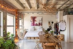 This book-filled loft designed by interior design company Oh Beauty offers just 900 square feet of living space, located in Los Angeles, California. Bedroom Loft, Bedroom Decor, 1980s Bedroom, Jungle Bedroom, Interior Bohemio, Brick Wall Bedroom, Brick Walls, Downtown Lofts, Bohemian Wall Decor