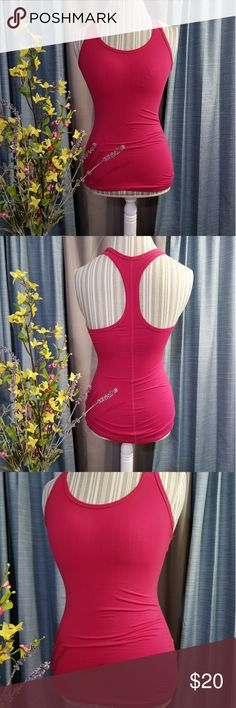 🌻🌺🌻NIKE RACERBACK COMPRESSION FIT!! SIZE:small   BRAND:Nike   CONDITION:like new, no flaws    COLOR:raspberry pink (hard to capture this color in photos)   🌟POSH AMBASSADOR, BUY WITH CONFIDENCE!   🌟CHECK OUT MY OTHER ITEMS TO BUNDLE AND SAVE ON SHIPPING!   🌟OFFERS WELCOME!   🌟FAST SHIPPING! Nike Tops