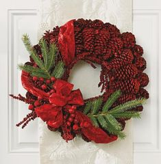 Homemade red pinecone wreath. How-to: http://www.midwestliving.com/homes/seasonal-decorating/beautiful-holiday-wreaths/page/1/0
