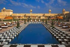 The swimming pool in the garden courtyard at The Oberoi Udaivilas offers an ideal venue to relax and reflect amidst the landscaped gardens.