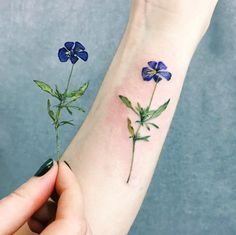 We can get over this gorgeous lifelike flower tattoo.