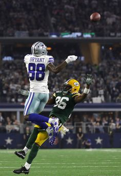 Dez Bryant of the Dallas Cowboys leaps for a pass during the fourth quarter  against the Green Bay Packers in the NFC Divisional Playoff game at ATT. d9543a81b1