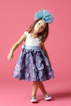 Watters 46710 Flower Girl Dress Round neckline with flower detail, Sleeveless, Shirred waist, Layered circles on A-line knee length skirt. FABRICS: LUMINESCENT TAFFETA. #timelesstreasure