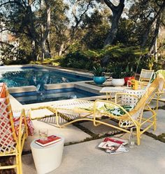 Retro style yellow lawn reclining chairs poolside