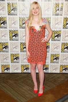 At Comic-Con, Elle Fanning had the same idea in mind when she selected Christopher Kane's neon lace sheath.