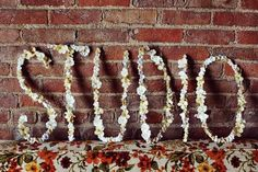 Place overized word art against a wall. | 28 Decorating Tricks To Brighten Up Your Rented Home