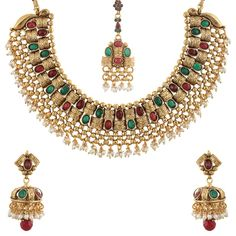 Look elegant and feminine by wearing this golden coloured necklace set with mang tikka for women from Sia Art Jewellery. Made from copper, this set of earrings and necklace can team with a saree, suit set or a lehenga set to look stunning.