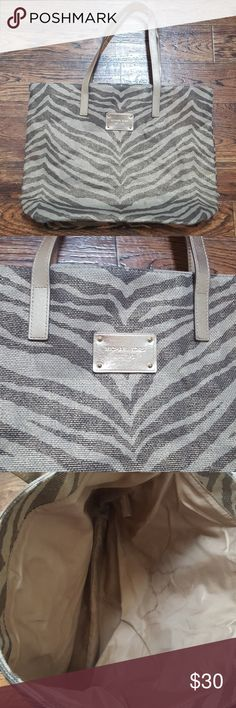 Michael Kors Zebra Print Woven Tote Gently used gold and zebra print tote. Good for beach or travel! Michael Kors Bags Totes