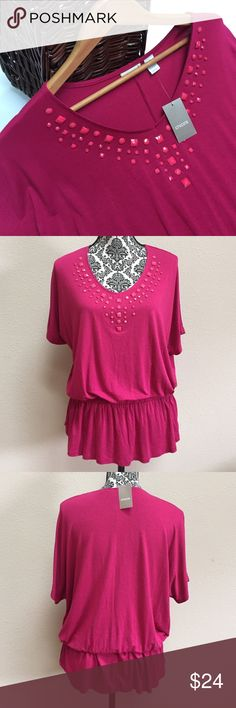 NWT Chico's peplum top blouse This is a NWT Chico's peplum top. Chico's size 1 which is considered a size 8 or size small. The color is a dark pink. Chico's Tops Blouses