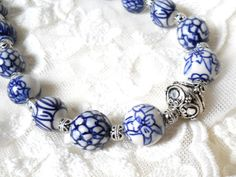 Blue necklace made of delft blue style handpainted ceramic beads and silvertone metal beads.  The necklength is approximately 45 cm. ( 17.7inches).  For