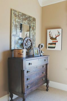 Boys room, vintage hunting theme. beautiful wood deer art. mix of rusty metals. Reserve at Old Fredericksburg Model Part 3, see the whole house at... Theraggedwren.blogspot.com