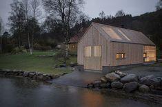 Naust V boathouse with pine plywood and polycarbonate sheets by Koreo Architects and Kolab Architects