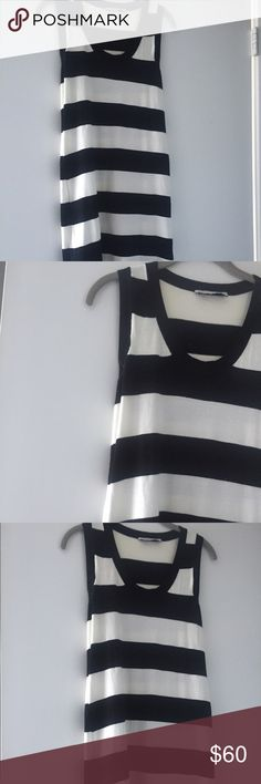 Stella McCartney Midi Dress Good condition hits about mid calf on 5'1 figure. Knit material. Fit a Small or Medium. Stretches so it is adaptable Stella McCartney Dresses Midi