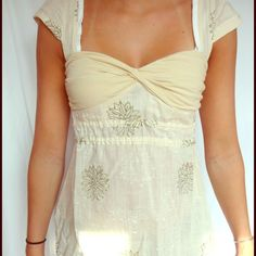 Free people top Off-white colored free people top, cris crosses in the back and ties behind. Sort of babydoll style but normal length. Willing to negotiate! Free People Tops