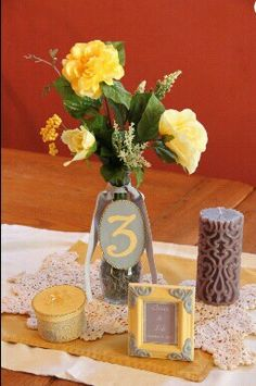 Unique yellow and gray wedding reception centerpiece