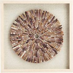 Bring the outdoor elements into your home with this contemporary framed wall art. Pebbles are stacked together and formed into a layered medallion. A square light brown hardwood frame surrounds the design for added dimension. Seashell Art, Seashell Crafts, Seashell Ornaments, Beach Crafts, Frames On Wall, Framed Wall Art, Rock Crafts, Diy Crafts, Wooden Crafts