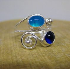 Sterling silver wire and fused glass ring.. ocean inspired.