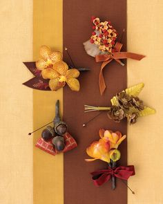 Pinecones, acorns, and fresh autumn blooms, such as freesia and phalaenopsis orchids, reference the hues and symbols of the season in these festive boutonnieres for the groom and his groomsmen.