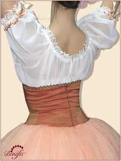 "Details: ballet dress. It is a professional stage costume, which is made on the basis of the professional basic romantic tutu #T0003 (see section ""Basic tutus""). A short-cut bodice is made of velvet fabric with a decorative lacing in front; it finishes under the bust and passes into chiffon light blouse with sleeves in the shape of small lamps on the elastic band. Wide skirt consists of 4 layers and 56 gussets. The length of the skirt is below the knee level. Satin braid in the color…"