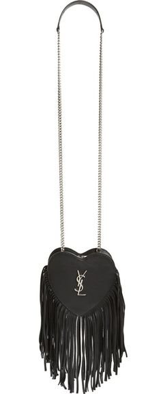 Dramatic fringe trim underscores the vintage rock-and-roll style of this heart-shaped crossbody bag fashioned from smooth leather and fronted with gleaming monogram hardware.